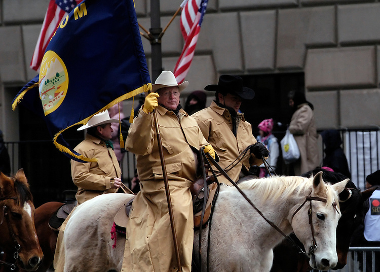 Sen. Conrad Burns, R-Mt., rides a horse during the 2005 Inaugural parade along Pennsylvania Ave.
