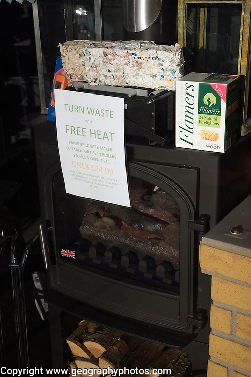 Display in solid fuel multi-fuel stove burner shop with paper waste bricks