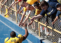 Shane Vereen high-fives fans on his way off the field. The California Golden Bears defeated the UCLA Bruins 35-7 at Memorial Stadium in Berkeley, California on October 9th, 2010.