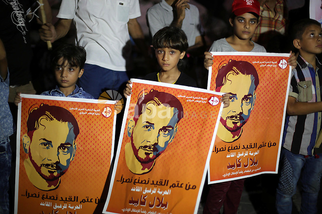 Palestinian children take part in a protest to show solidarity with Palestinian prisoner Bilal Kayed, who has been fasting for almost two months over his detention without trial, in Gaza seaport, on August 18, 2016. Kayed was to be released in June after serving a 14-and-a-half-year sentence for activities in the leftist Popular Front for the Liberation of Palestine (PFLP), labelled a terrorist organisation by Israel, the European Union and the United States. Instead, Israeli authorities ordered that he remain in custody under the administrative detention law, which allows prisoners to be held without trial for renewable six-month periods. Photo by Mohammed Asad
