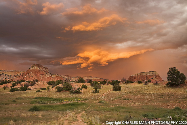 The red sandstone cliffs of Kitchen Mesa at Ghost Ranch can become dramatic on a stormy summer day at sunset.