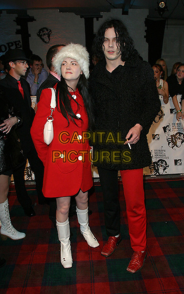THE WHITE STRIPES.MTV Europe Music Awards 2003 Held At The Western Harbour, Leith, Edinburgh, Scotland.Ref: Ten.full length, full-length, red jacket, coat, white boots, fur hat, Jack, Meg.www.capitalpictures.com.sales@capitalpictures.com.©Capital Pictures