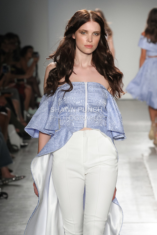 Model walks runway in resortwear from Alphabe The Label Spring Summer 2017 collection by Brenda Chang and Cathy Karuga, for the Fashion Palette Austrialian Swim Resort Spring Summer 2017 fashion show on September 8, 2016.