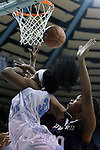 14 November 2014: North Carolina's Xylina McDaniel (34) is fouled by Howard's Jordan Coleman (right). The University of North Carolina Tar Heels hosted the Howard University Bison at Carmichael Arena in Chapel Hill, North Carolina in a 2014-15 NCAA Division I Women's Basketball game. UNC won the game 83-49.