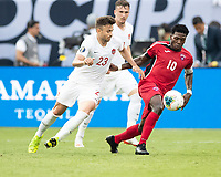 CHARLOTTE, NC - JUNE 23: Aricheell Hernandez #10 and Marcus Godinho #23 vie for the ball during a game between Cuba and Canada at Bank of America Stadium on June 23, 2019 in Charlotte, North Carolina.