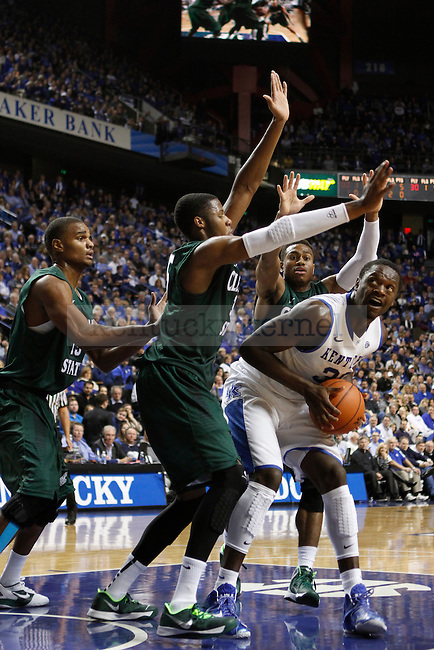 UK forward Julius Randle is surrounded by three Cleveland State players during the second half of the University of Kentucky men's basketball game vs. Cleveland State at Rupp Arena in Lexington, Ky., on Monday, November, 25, 2013. UK won 68-61. Photo by Jonathan Krueger | Staff