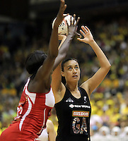 09.07.2011 Silver Ferns Maria Tutaia in action during the netball match between Silver Ferns and England at the Mission Foods World Netball Championship 2011 held at the Singapore Indoor Stadium in Singapore . Mandatory Photo Credit ©Michael Bradley.
