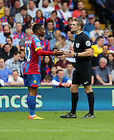 Pictured L-R: Jason Puncheon of Crystal Palace protest to match referee C Pawson<br />