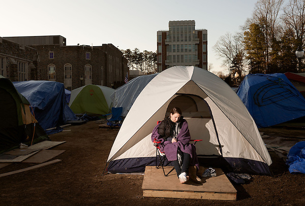 January 23, 2013. Durham, North Carolina. Jacqueline Chipkin, a freshman from Maryland, checks her phone outside her tent in K-Ville where students camp out to get tickets for home basketball games at Cameron Indoor Stadium. Students stay for weeks leading up to the game versus arch rival UNC.. Duke University has become a power house in the national college basketball arena under the coaching of head coach Mike Krzyzewski. But the university has fought hard to maintain its image of high academic achievement while riding the wave of collegiate athletic success.