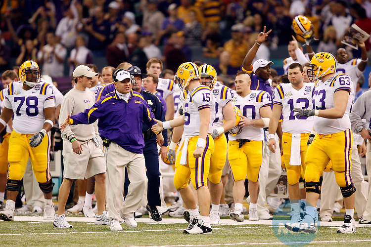 07 JAN 2008:  Louisiana State University  Head Coach Les Miles congratulates quarterback Matt Flynn (15) on the Tigers victory over Ohio State University during the BCS National Championship held at the Superdome in New Orleans, LA.  LSU defeated Ohio State 38-24 for the national title.  Jamie Schwaberow/NCAA Photos