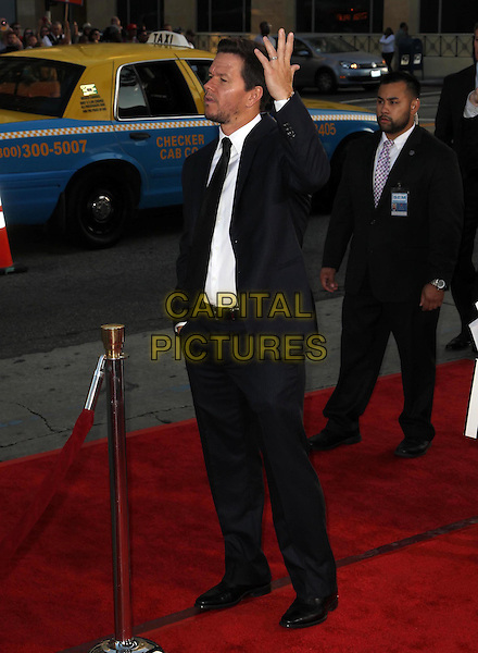 Mark Wahlberg.The L.A. Premiere of 'Ted' held at The Grauman's Chinese Theatre in Hollywood, California, USA..June 21st, 2012.full length white shirt black tie blue suit hand arm profile side looks angry upset .CAP/ADM/KB.©Kevan Brooks/AdMedia/Capital Pictures.