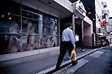 TOKYO - DEC. 9:Pedestrian walks past a Beatles mural on the wall of The Cavernn Club in Roppongi, Tokyo. (Photo by Alfie Goodrich/Nippon News)
