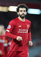 2nd January 2020; Anfield, Liverpool, Merseyside, England; English Premier League Football, Liverpool versus Sheffield United; Mohammed Salah of Liverpool runs into position as Liverpool win a corner kick in front of the Kop  - Strictly Editorial Use Only. No use with unauthorized audio, video, data, fixture lists, club/league logos or 'live' services. Online in-match use limited to 120 images, no video emulation. No use in betting, games or single club/league/player publications