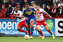 John Bostock of Swindon escapes from Greg Tansey of Stevenage. Stevenage v Swindon Town - npower League 1 -  Lamex Stadium, Stevenage - 27th October, 2012. © Kevin Coleman 2012.