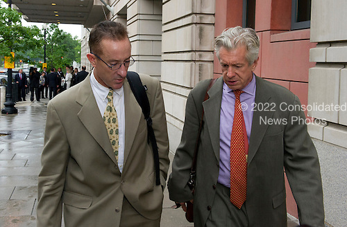 Brian McNamee speaks with an unidentified person as he departs U.S. District Court in Washington, D.C. following his first day of testimony against former New York Yankee pitcher Roger Clemens on Monday, May 14, 2012..Credit: Ron Sachs / CNP.(RESTRICTION: NO New York or New Jersey Newspapers or newspapers within a 75 mile radius of New York City)