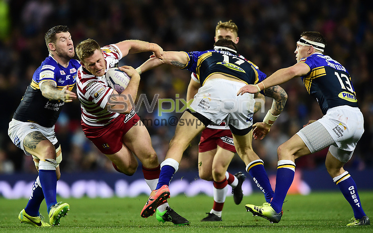 Picture by Alex Broadway/SWpix.com - 10/10/2015 - Rugby League - First Utility Super League Grand Final - Leeds Rhinos v Wigan Warriors - Old Trafford, Manchester, England - Larne Patrick of Wigan Warriors is tackled by Brett Delaney and Adam Cuthbertson of Leeds Rhinos.