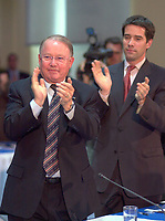 June 6 , 2002, Montreal, Quebec, Canada<br /> <br />  Bernard Landry, Quebec Premier (L) and<br /> Andre Boisclair, Quebec Minister Municipal Affairs,<br /> Quebec Minister Environment applaud (R)<br />  after Gerald Tremblay, Montreal Mayor <br /> speech at  the closing  of the Montreal Summit<br />  (Le Sommet de Montr&raquo;al), June 6, 2002<br /> <br /> <br />  <br /> Mandatory Credit: Photo by Pierre Roussel- Images Distribution. (&copy;) Copyright 2002 by Pierre Roussel <br /> ON SPEC<br /> NOTE l Nikon D-1 jpeg opened with Qimage icc profile, saved in Adobe 1998 RGB.