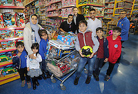 Pictured: Neil Taylor and Gylfi Sigurdsson Wednesday 08 December 2016<br />Re: Swansea City FC players have bought Christmas gifts for 60 children at Smyths toy store in Swansea, south Wales.