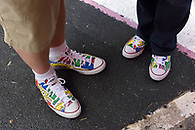 Colorful painted Converse sneakers.