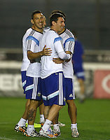 Maxi Rodriguez hugs Lionel Messi of Argentina during the training session