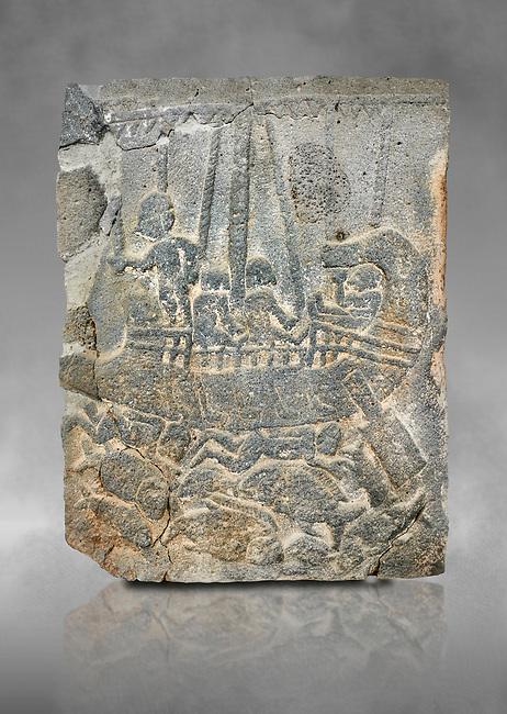 Pictures & images of the North Gate Hittite sculpture stele depicting a ship with fish. 8the century BC.  Karatepe Aslantas Open-Air Museum (Karatepe-Aslantaş Açık Hava Müzesi), Osmaniye Province, Turkey. Against grey art background