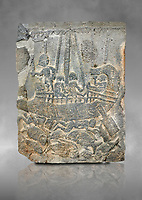 Pictures & images of the North Gate Hittite sculpture stele depicting a ship with fish. 8the century BC.  Karatepe Aslantas Open-Air Museum (Karatepe-Aslantaş Açık Hava Müzesi), Osmaniye Province, Turkey. Against grey art background