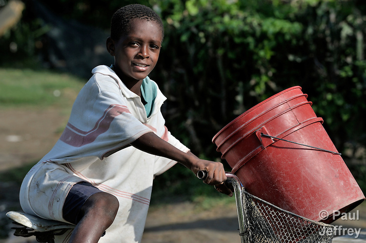 A boy fetches water on his bicycle in the Haitian village of Vaudreuil.