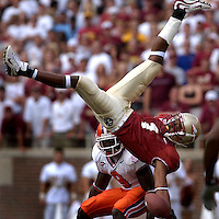 TALLAHASSEE, FL. 9/25/04-CH 13 FSUCLEM26-FSU's Craphonso Thorpe makes a one hand catch but could not hold the ball on impact as Clemson's Justin Miller watches during first half action Saturday at Doak Campbell Stadium in Tallahassee...COLIN HACKLEY PHOTO FOR SPORTS SECTION  STORY BY CARLSON