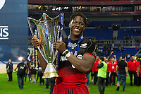 Maro Itoje of Saracens with the European Rugby Champions Cup trophy. European Rugby Champions Cup Final, between Saracens and Racing 92 on May 14, 2016 at the Grand Stade de Lyon in Lyon, France. Photo by: Patrick Khachfe / Onside Images