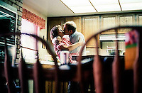 Steve Nelson and Phyllis Nelson kissing in the kitchen, 1987.   &amp;#xA;<br />