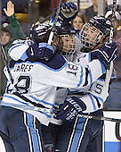 Maine celebrates - Josh Soares, Derek Damon, Greg Moore - The Boston College Eagles defeated the University of Maine Black Bears 4-1 in the Hockey East Semi-Final at the TD Banknorth Garden on Friday, March 17, 2006.