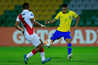 ARMENIA, COLOMBIA - JANUARY 19: Brazil's Paulinho fights for the ball against Peru's Eduardo Rabanal during their CONMEBOL Pre-Olympic soccer game at Centenario Stadium on January 19, 2020 in Armenia, Colombia. (Photo by Daniel Munoz/VIEW press/Getty Images)