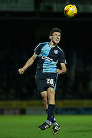 Luke O'Nien of Wycombe Wanderers wins the ball in the air during the Sky Bet League 2 match between Yeovil Town and Wycombe Wanderers at Huish Park, Yeovil, England on 24 November 2015. Photo by Andy Rowland.