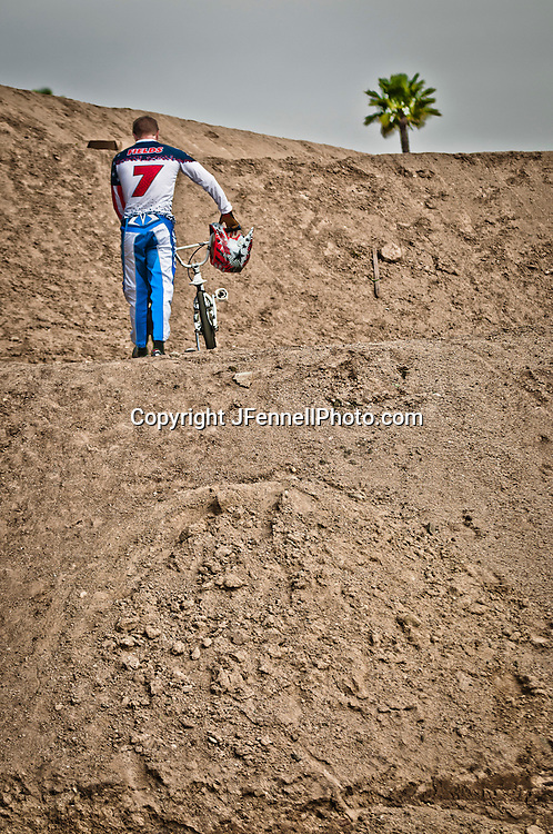 Connor Fields on long walk back up the big hill to the starting gate at the US Olympic Training Center in Chula Vista, CA