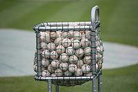 A cart full of baseballs sits on the field prior to the start of the game between the Salt Lake Bees and the Colorado Springs Sky Sox in Pacific Coast League action at Smith's Ballpark on May 22, 2015 in Salt Lake City, Utah.  (Stephen Smith/Four Seam Images)