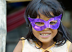 A girl wears a mask in the village of Phar Thruey in northern Cambodia.
