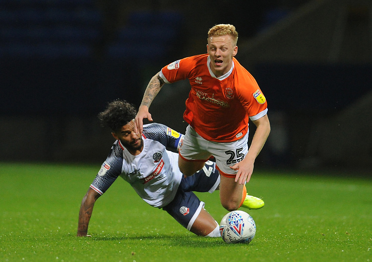 Blackpool's Callum Guy is fouled by Bolton Wanderers' Liam Bridcutt<br /> <br /> Photographer Kevin Barnes/CameraSport<br /> <br /> The EFL Sky Bet League One - Bolton Wanderers v Blackpool - Monday 7th October 2019 - University of Bolton Stadium - Bolton<br /> <br /> World Copyright © 2019 CameraSport. All rights reserved. 43 Linden Ave. Countesthorpe. Leicester. England. LE8 5PG - Tel: +44 (0) 116 277 4147 - admin@camerasport.com - www.camerasport.com