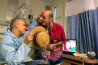 """Cris L'ariste an Israeli  medical clown who works in Hadassah member of a group call """"Dream Doctor"""" plays with Mustafah Mshasha, a Palestinian boy from the Old City of Jerusalem receives chemotherapy at the Oncology Day Care unit at Hadassah Ein Karem hospital. ..Mustafa suffers from Leukemia and has been treated in the Children Oncology Unit. Photo by Quique Kierszenbaum  .."""