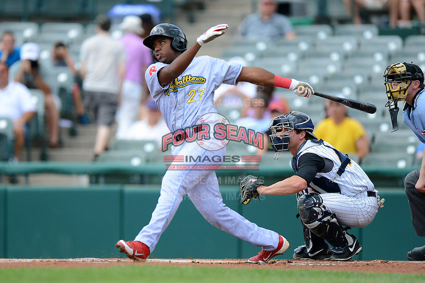 Reading Fightin Phils third baseman Maikel Franco #27 at bat in front of catcher Jeff Farnham during a game against the Trenton Thunder on July 8, 2013 at Arm & Hammer Park in Trenton, New Jersey.  Trenton defeated Reading 10-6.  (Mike Janes/Four Seam Images)