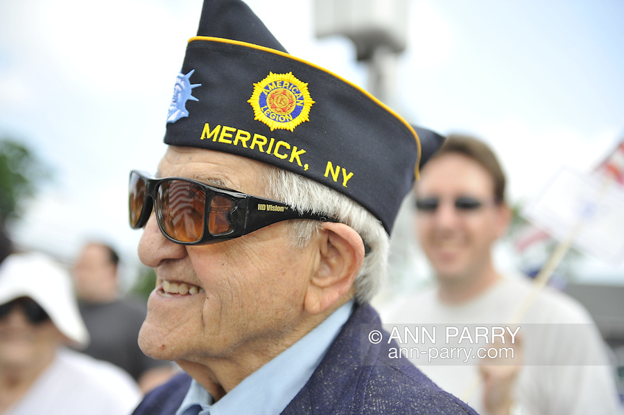 American Legionnaire marching in Merrick Memorial Day Parade on May 28, 2012, on Long Island, New York, USA. Veteran is member of American Legion Merrick Post 1282, which hosted the parade and ceremony. America's war heroes are honored on this National Holiday.