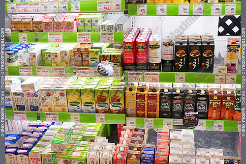 Non-alcoholic drinks, coffee, tea, milk, yogurt on display in a Japanese supermarket. Tokyo, Japan.
