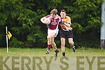 Donnacha Wash of Cromane breaks away from Asdee's Eoim O'Carrol last Saturday night in Asdee.