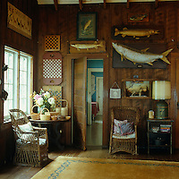 This rustic entrance hall is decorated with a collection of fish and other memorabilia