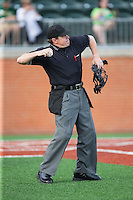 Home plate umpire Gary Swanson throws a baseball to the pitcher during the NCAA baseball game between the Wake Forest Demon Deacons and the Charlotte 49ers at Hayes Stadium on March 16, 2016 in Charlotte, North Carolina.  The 49ers defeated the Demon Deacons 7-6.  (Brian Westerholt/Four Seam Images)