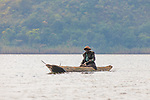 Man In Dugout Canoe On Lake Mutanda