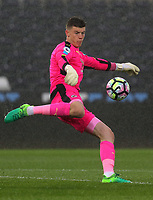 Pictured: George Legg of Reading takes a kick Monday 15 May 2017<br /> Re: Premier League Cup Final, Swansea City FC U23 v Reading U23 at the Liberty Stadium, Wales, UK