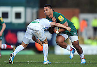 Manu Tuilagi is tackled by Phil Dollman. Aviva Premiership match, between Leicester Tigers and Exeter Chiefs on March 23, 2014 at Welford Road in Leicester, England. Photo by: Patrick Khachfe / JMP