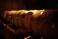 Wine ages in oak barrels in a wine cellar at a Niagara Peninsula vineyard in Ontario