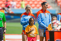 Houston, TX - Saturday May 13, Houston Dash players Kealia Ohai and Lydia Williams stand for the national anthem during a regular season National Women's Soccer League (NWSL) match between the Houston Dash and Sky Blue FC at BBVA Compass Stadium. Sky Blue won the game 3-1.