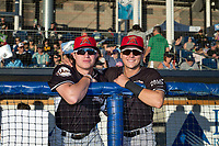 Salem-Keizer Volcanoes teammates Seth Corry (28) and Nico Giarratano (6) pose for a photo before a Northwest League game against the Hillsboro Hops at Ron Tonkin Field on September 1, 2018 in Hillsboro, Oregon. The Salem-Keizer Volcanoes defeated the Hillsboro Hops by a score of 3-1. (Zachary Lucy/Four Seam Images)